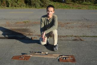 A picture of Jed and the arrowheads and arrows he made.